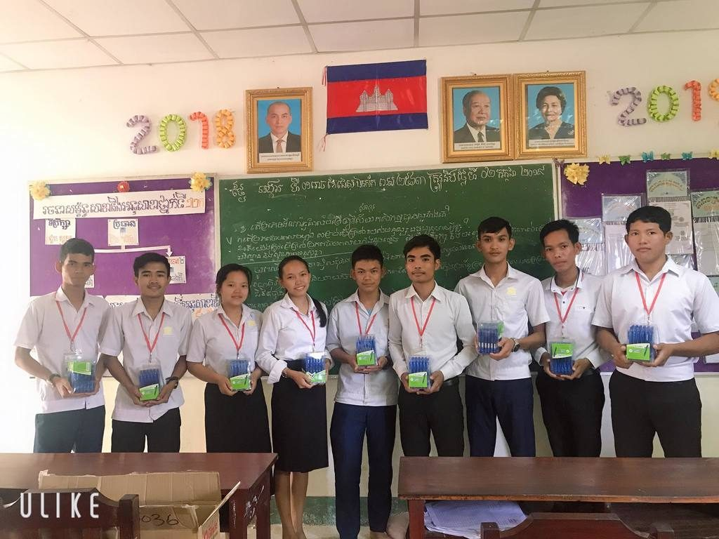 students with pens